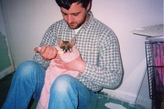Trevor feeding a fox cub at Peacehaven 2003
